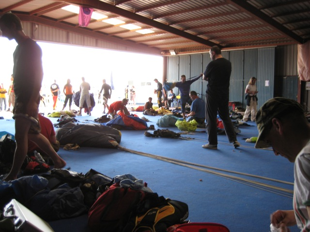 A busy packing shed during the Spanish national canopy piloting championships